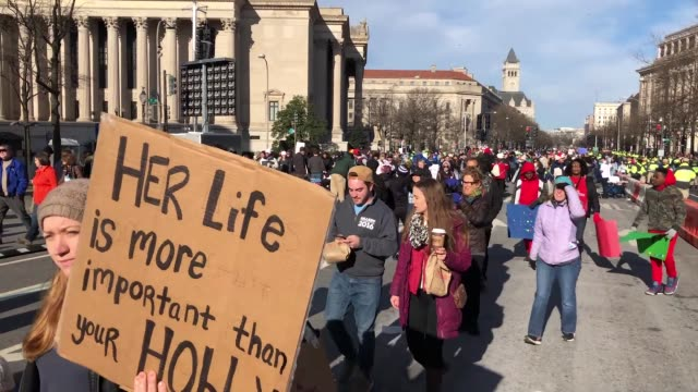 gun reform advocates line pennsylvania avenue while attending the march for our lives rally march 24 2018 in washington dc hundreds of thousands of... - march for our lives video stock e b–roll