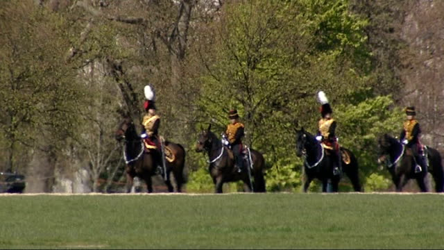 gun salute to mark queen's 84th birthday; england: london: hyde park: ext troopers from the royal horse artillery taking position / procession of... - queen's birthday stock videos & royalty-free footage