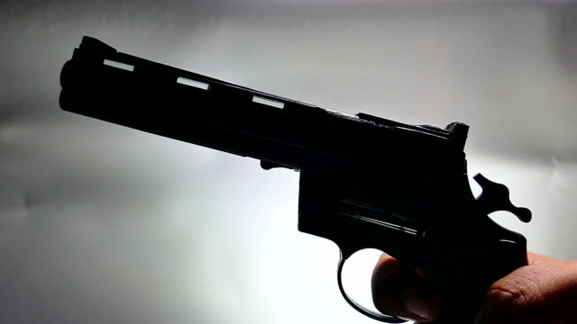 gun shooting, slow motion - handgun stock videos and b-roll footage