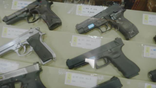 gun shop and/or bb gun shop. - gun shop stock videos and b-roll footage