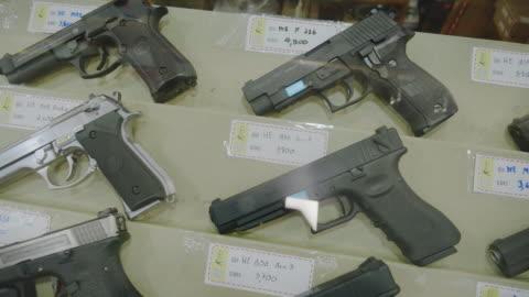 gun shop and/or bb gun shop. - handgun stock videos & royalty-free footage