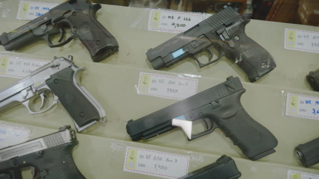 gun shop and/or bb gun shop. - arma da fuoco video stock e b–roll