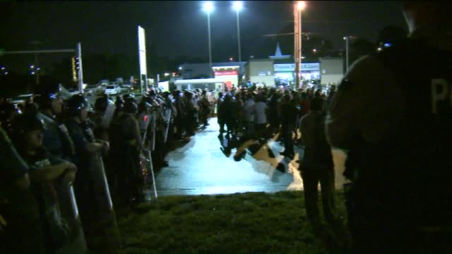 ktvi gun shots heard camera operator runs for cover at mike brown shooting anniversary protest on august 9 2015 in ferguson missouri - st. louis missouri stock videos & royalty-free footage