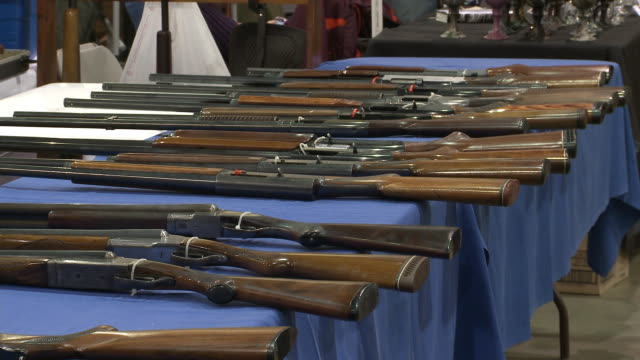 gun show at showmasters gun shows on march 23 2013 in richmond virginia - exhibition stock videos and b-roll footage