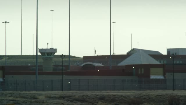 "gun towers and the exterior of the united states penitentiary, administrative maximum facility supermax prison complex in florence, colorado (fremont county) under the rocky mountains - the ""alcatraz of the rockies"" - jail cell stock videos & royalty-free footage"