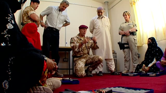gun training programme for women police officers afghanistan helmand province int various views of british army officer showing trainee afghani women... - military recruit点の映像素材/bロール