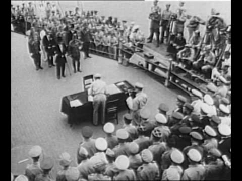 gun turret of the uss missouri site of the japanese surrender in world war ii / montage allied officials with japanese instrument of surrender... - japanese surrender stock videos and b-roll footage