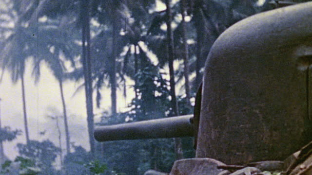 stockvideo's en b-roll-footage met ms gun turret on a tank as cannon fires in the jungle / talasea new britain papua new guinea - keyable