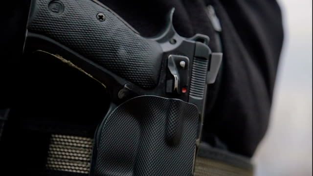 gun,close up - police force stock videos & royalty-free footage