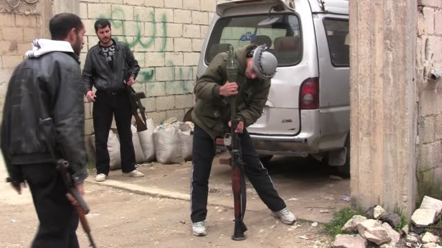 A gunfight between members of the Free Syrian Army and a Christian family in the town of Al Qusayr Syria During a demonstration after the Friday...