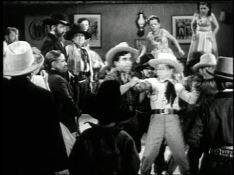1938 montage gunfight in the saloon in the film 'terror of tiny town' / united states - wild west stock videos & royalty-free footage
