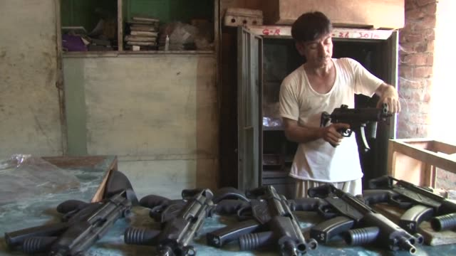 gunfire echoes through a dusty northwest tribal town the soundtrack to pakistan's biggest arms black market where kalashnikovs welded from scrap... - soundtrack stock videos & royalty-free footage