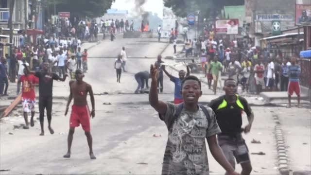 gunfire erupts in several parts of kinshasa as congo's long serving president joseph kabila appears set to stay on despite the expiry of his mandate... - democratic republic of the congo stock videos & royalty-free footage
