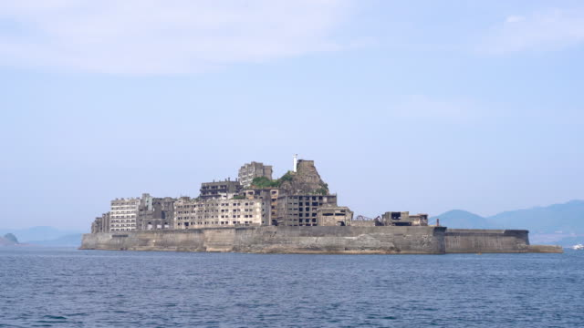 gunkanjima (hashima island) view from the sea - battleship stock videos & royalty-free footage