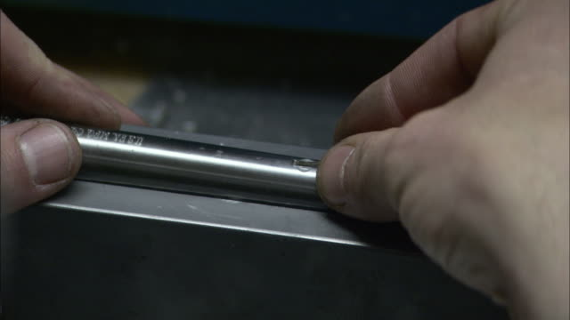 a gunmaker places the front sight on a gun muzzle. - gun stock videos & royalty-free footage