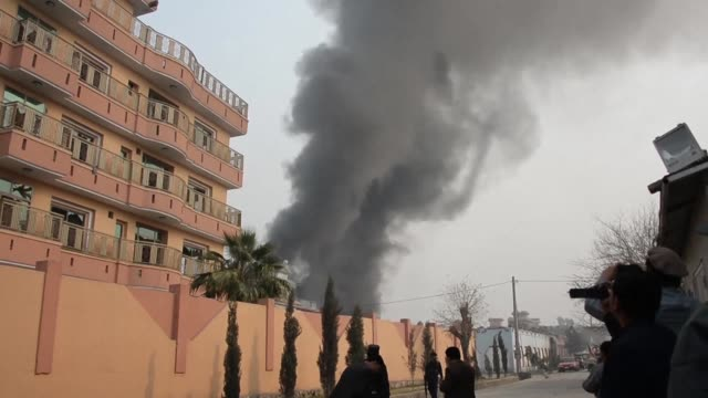 vídeos y material grabado en eventos de stock de gunmen blast their way into save the children's office in afghanistan's restive east witnesses and officials say killing at least two people dead and... - afganistán