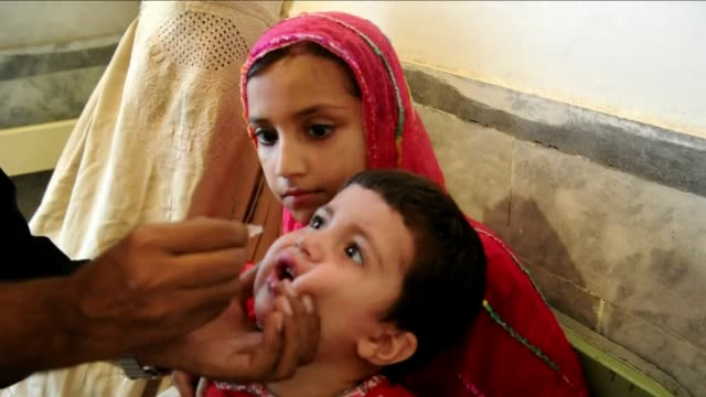 gunmen in pakistan mounted fresh attacks wednesday on health workers carrying out polio vaccinations taking the death toll to nine and prompting... - polio stock videos and b-roll footage