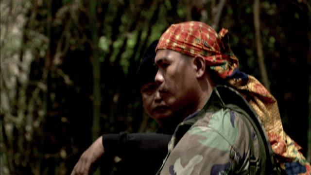 Gunmen keep watch in the jungle.