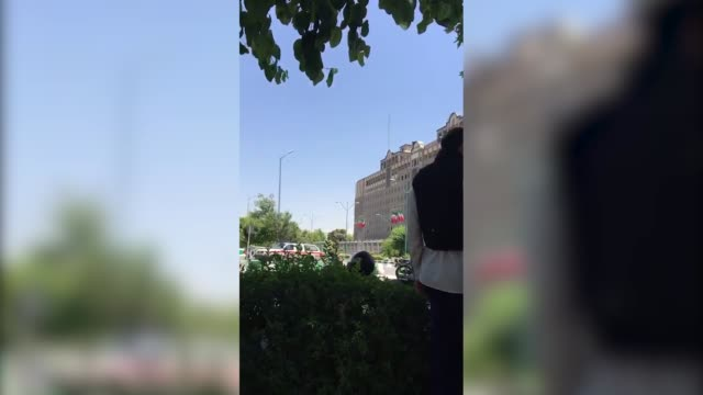 gunmen opened fire at iran's parliament and the shrine of ayatollah khomeini in the capital tehran on june 07 killing at least six people four men... - 武装犯点の映像素材/bロール