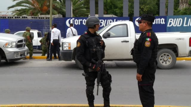gunmen stormed a beer business in northern mexico on friday, killing 10 people in broad daylight and leaving some of the victims naked, officials said - northern mexico stock videos & royalty-free footage