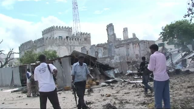 gunmen wearing suicide vests stormed the main court complex in mogadishu sunday killing at least five people before holing themselves up as somali... - holing stock videos & royalty-free footage