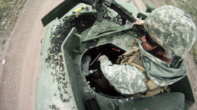 gunner adjusts position in humvee - convoy stock videos and b-roll footage