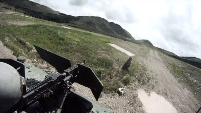 gunner prepares his machine gun on a humvee - machine gun stock videos & royalty-free footage