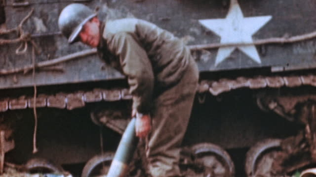 gunner preparing howitzer shell, and m7 priest firing m101 howitzer / germany - howitzer stock videos & royalty-free footage