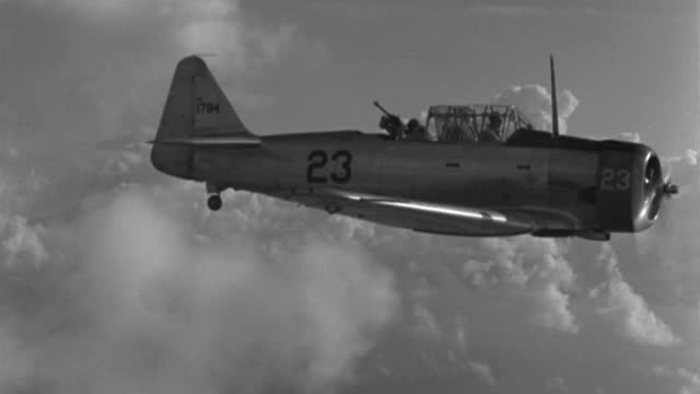 a gunner works a machine gun in the back of an airplane in flight. - 1943 stock videos & royalty-free footage