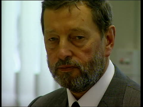 Home Secretary David Blunkett MP sat with Home Office Minister Bob Ainsworth and others at guns summit Sign for Home Secretary Blunkett CBV Blunkett...