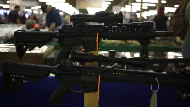 guns are displayed for sale at a gun show during the fall 2015 knob creek machine gun shoot at knob creek gun range in west point kentucky us on... - knob stock videos and b-roll footage