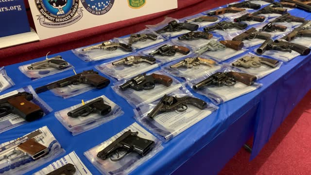 guns are displayed on a table during a gun buy-back event at a church in staten island on april 24, 2021 in new york city. the one-day event, held at... - gun stock videos & royalty-free footage