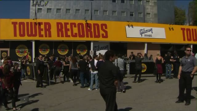 guns n' roses announces surprise show at troubadour in west hollywood. shots of people waiting in line, receiving wrist bands. - tower records stock videos & royalty-free footage