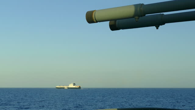 guns of a warship against the background of the ferry - convoy stock videos & royalty-free footage