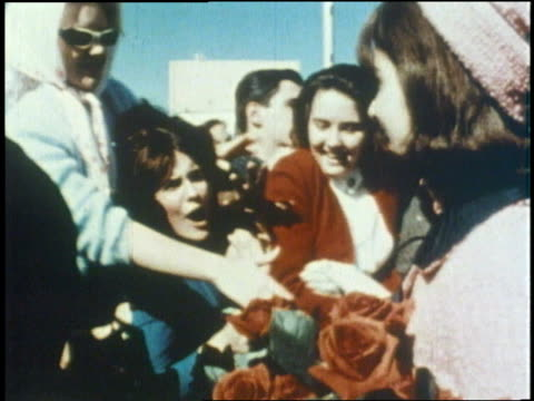 stockvideo's en b-roll-footage met gunshots wound us president john f kennedy as he rides in a motorcade with his wife jacqueline kennedy in dallas texas on november 22 1963 - jacqueline kennedy