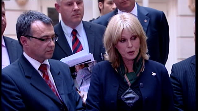 gurkha residency rights row: joanna lumley confronts phil woolas; **beware flash photography** various of lumley and woolas along and down stairs,... - high speed photography stock videos & royalty-free footage