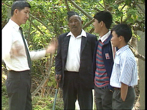 gurkha units merged nepal ms side group of ex gurkhas sitting cms ex gurkha grung who was awarded vc ms grung standing with grandsons ms side male... - nepal stock-videos und b-roll-filmmaterial