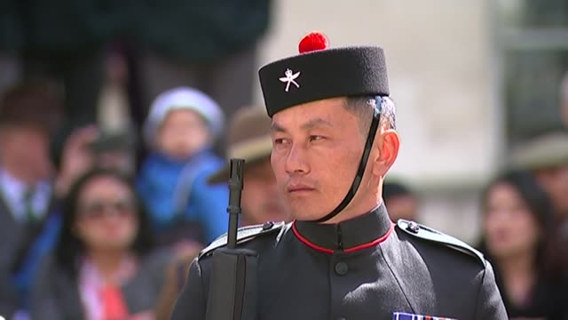 gurkhas commemorate 200 years of service in the british army but thoughts are with those at home wreath being laid at memorial with others various of... - saluting stock videos and b-roll footage