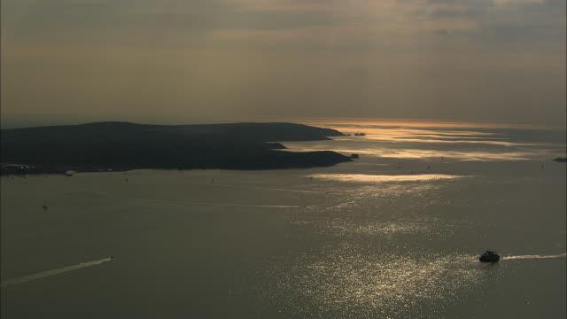 AERIAL Gurnard Bay at sunset / Isle of Wight, United Kingdom