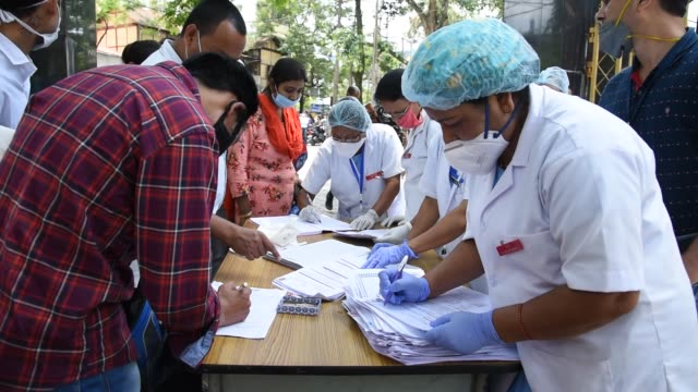 guwahati assam india 2 june 2020 health workers receives job application from applicants at mahendra mohan choudhury hospital during covid19 lockdown... - unemployment application stock videos & royalty-free footage