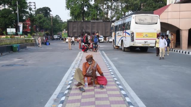 guwahati assam india 2 june 2020 stranded indian people takes rest in a makeshift shelter outside guwahati railway station as he waits for a train... - obscured face stock videos & royalty-free footage