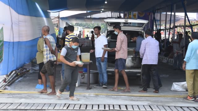 guwahati assam india 4 june 2020 stranded indian people in queue to take food from volunteers outside guwahati railway station as they waits for a... - obscured face stock videos & royalty-free footage