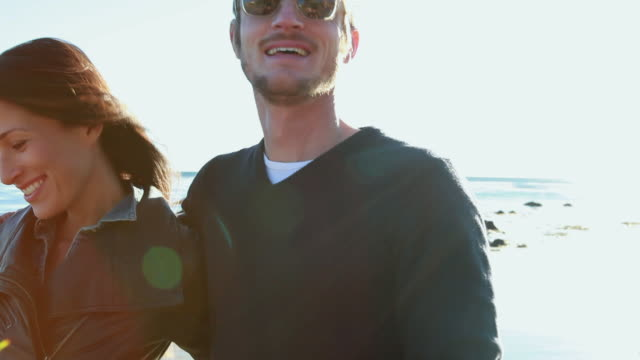 cu guy and two girls walking and enjoying on beach / malibu, california, united states - malibu stock videos & royalty-free footage