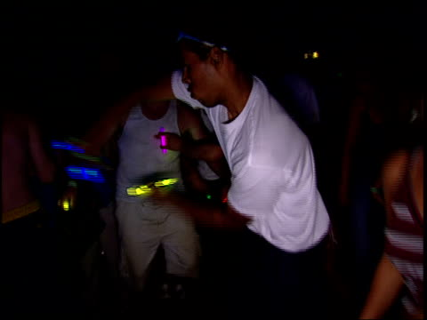 Guy Dancing with Glowsticks at a Rave