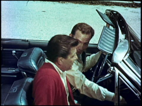 guy driving his new rambler american 440 convertible picks up his buddy for a round of golf. as they cruise through the suburbs, his friend compares... - 1966 bildbanksvideor och videomaterial från bakom kulisserna