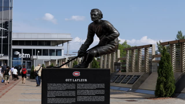 ms t/l guy lafleur statue in front of bell centre / montreal, quebec, canada - montréal stock videos & royalty-free footage