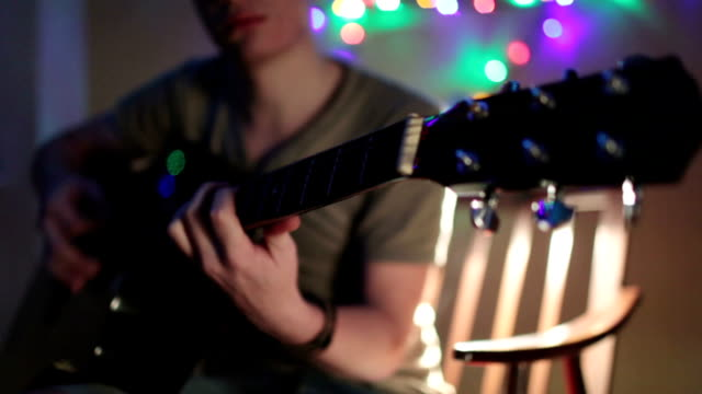 guy playing guitar - carol singer stock videos & royalty-free footage
