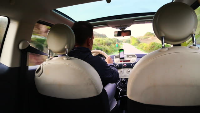 guy riding car on the menorca island roads heading to the favaritx lighthouse on the morning with nice point of view. - minorca stock videos & royalty-free footage