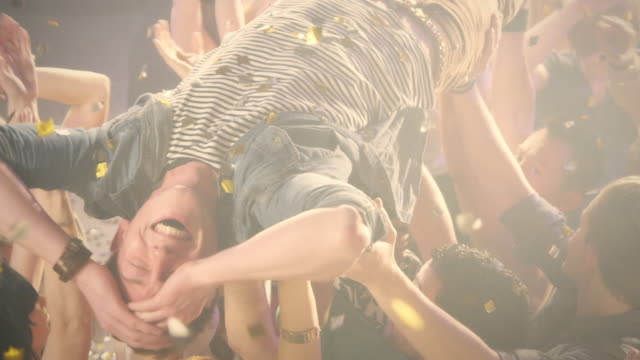 Guy stage diving
