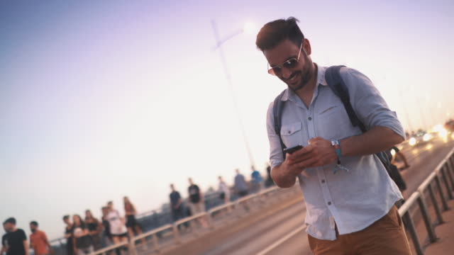 Guy using a smart phone. 4k